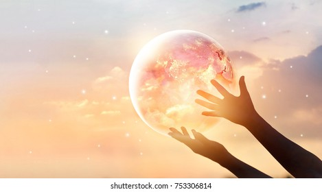 Save the world energy campaign. Planet earth on human hands show energy consumption of humanity at night, Elements of this image furnished by NASA