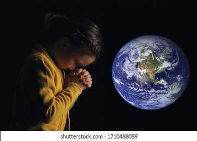 Save of the world, environment concept. Beautiful planets world and a little cute asian girl raising her hands to pray on black background. Elements of this image furnished by NASA.
