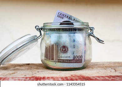 Saved one thousand naira notes savings jar notes for personal finances, savings and investment concepr