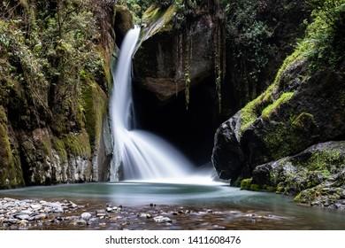 Savegre river waterfall, San Gerardo de Dota, Costa Rica. Low shutter speed stream. yoga concept.