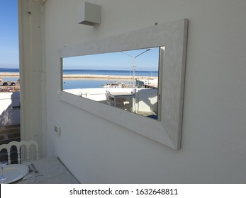 savelletri port in winter throughout a mirror. Apulia, Italy.