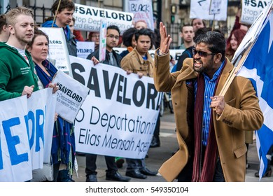 #SaveLord Protest, Edinburgh, Scotland, 21st May 2016 Protester shouts to other protesters outside Scottish Public Services Ombudsman building to protest deportation of Lordapetsi McMensah