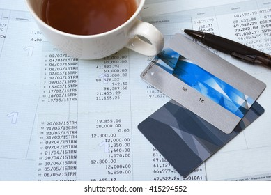 Saving account from bank and Credit card with pencil for financial and loan and a cup of coffee
