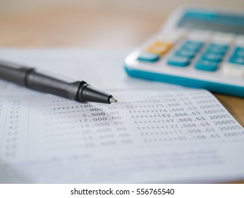 Saving Account Book from Bank for Business Finance with pen and calculator