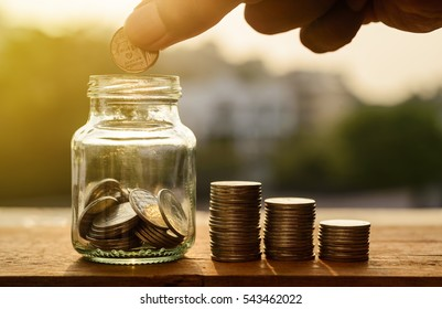 Saving account and money finance bank for prepare concept, Hand with money coin stack growing business, Save money retirement concept
