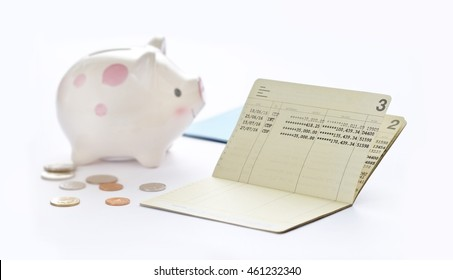 Saving account passbook, book bank and piggy bank on white background