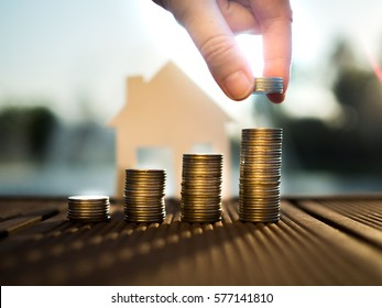 Saving to buy a house that hand putting money coins stack growing ,saving money or money growth concept