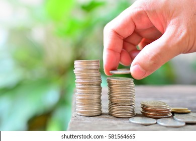 saving coins for investment concept business and finance