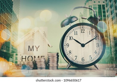 saving concept, stacking coins and wooden home replica over double exposure background