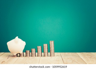 Saving Concept-Coins stacked with piggy bank