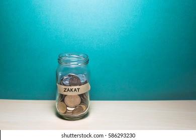 Saving Concept.with text zakat(zakat is a form of alms-giving treated in islam as a religious obligation or tax)