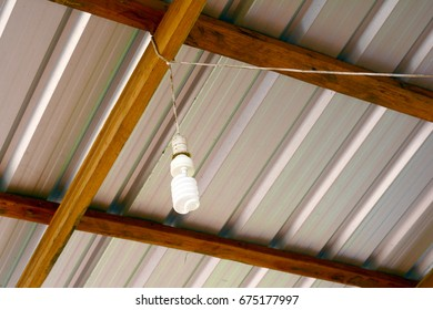 saving energy bulb with line tie on wood structure