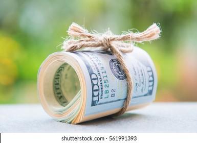 saving money with american dollars , cash