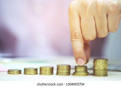 Saving money. businessman hand putting stack coins to show concept of growing savings money finance business and wealthy.