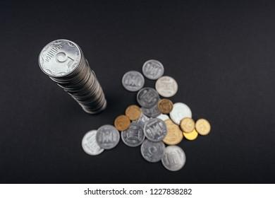 Saving money coin stacks tower dark background Ukrainian hryvnia