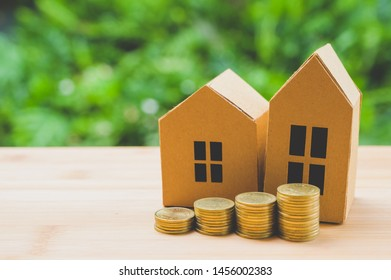 Saving money concept. Buy house, stack of coins.