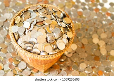 Saving money concept of collecting coins in a basket with coins background. as background business concept and Saving concept.