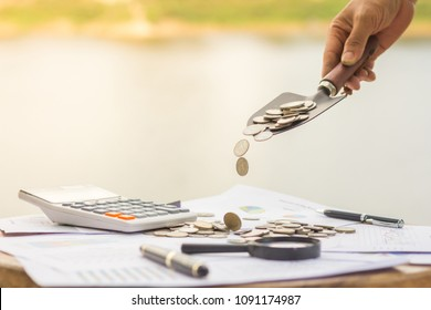 Saving money concept, Male hand putting money coin stack growing business, Investment saving money for growing business and future concept