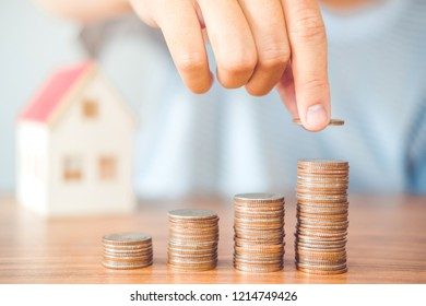 Saving money concept man hand putting coin stack finance for budget