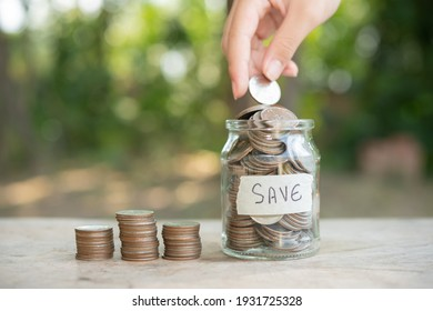 Saving money concept preset by Male hand putting money coin stack growing business. Arrange coins into heaps with hands, content about money.