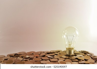 Saving money concept preset by money coin growing business.Tag save, saving pile of coins. Saving money for buying a house, Housing Loan concept.Saving money into bottle for cash in future investment.