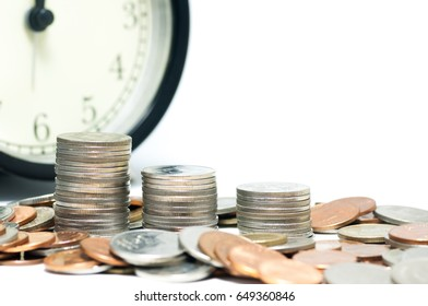 Saving money concept,Coins stack and clock on white background