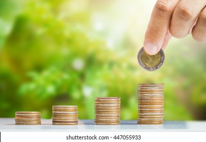 Saving money concept,Investment,Business man hand putting money coin stack growing business