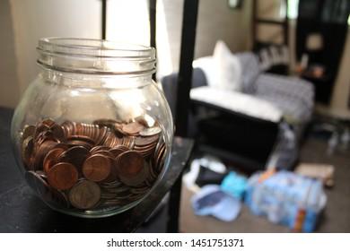 saving money in glass jars