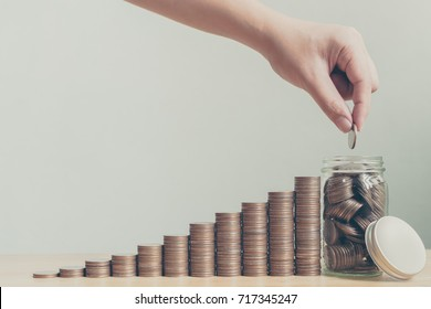 Saving money and investing is growing growth wealthy and sustainable for the future concept, Hand of male or female putting coin stack step growing growth financial, Copy space for your text