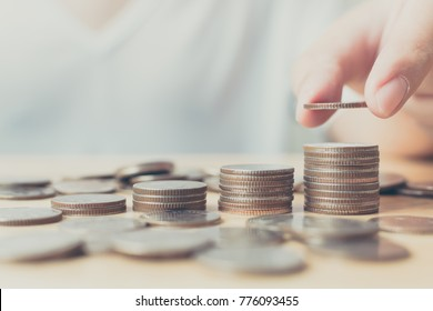 Saving money for investment concept, Hand of male or female putting coin stack step growing growth financial