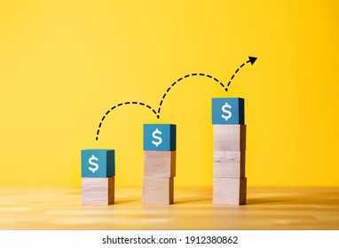 Saving money or profit increase concepts with text on wood blog.financial and investment growth.