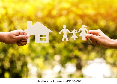 The saving money for real estate owner in the future concept, a man and woman hand holding a family and home with model in the public park.