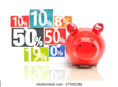 Saving money - red piggy bank with multicolored newspaper percentage adverts