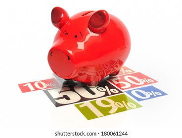 Saving money - red piggy bank on multicolored newspaper percentage advertisements