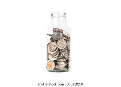 saving thailand coins in open bottle on white background