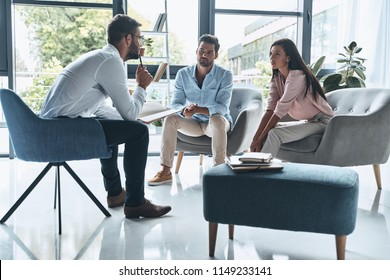 Saving their relationships. Young married couple talking while sitting on the therapy session with psychologist