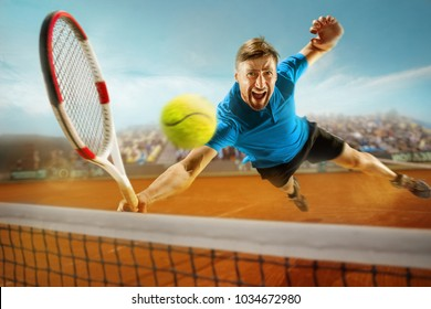 I am saving this ball now. Player lunge, game of defense. The one caucasian fit man playing tennis at the earthen court with spectators. Player jumping in full length with racquet and ball. Emotions