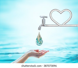 Saving water concept with faucet pipe in heart love shape. Element of this image furnished by NASA