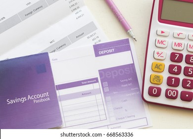 savings account pass book bank and slip deposit for payment expense of credit card