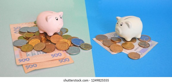 Savings concept. Ukrainian economic system. Ukrainian salary poverty. Crisis exchange rate. Default and depreciation. Two piggy banks hryvnia and euro banknotes and coins on turquoise background.