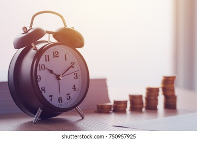 Savings, finances, economy and home budget calculations. Vintage clock and coins stacked on home desk.