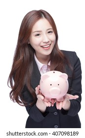 Savings woman smiling happy and holding pink piggy bank isolated on white background. Asian girl