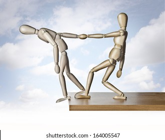 Savior. Two manikins, anatomical model, placed on the edge of a board