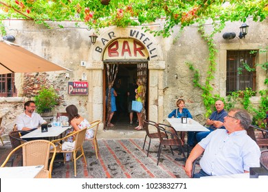 Savoca, Italy - September 27, 2017: Vitelli bar with tourists in Savoca, Sicily, Italy. It is a place from the film Godfather.