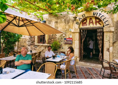 Savoca, Italy - September 27, 2017: Vitelli bar with tourists in Savoca, Sicily island, Italy. It is a place from the film Godfather.