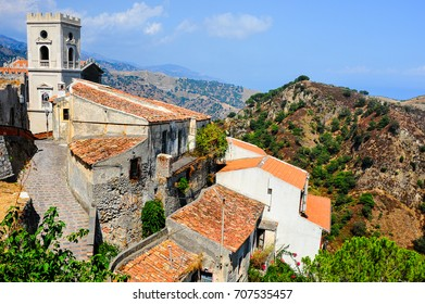 Savoca, Sicily - orange rooftops, stone walls, and Church of St. Nicholas looking to valley below. Setting for numerous films, most notably the Godfather