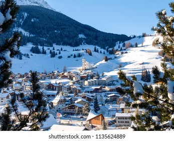 Savognin, Switzerland Snowy and sunlit tourist village