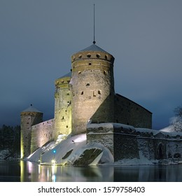 SAVONLINNA, FINLAND - JANUARY 9, 2013: Castle Olavinlinna (Olofsborg) in winter dusk. The fortress was founded in 1475. Today it is the northernmost medieval stone fortress still standing.