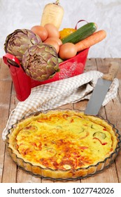 Savory cake with vegetables, cream, eggs and parmesan cheese on tart pastry.