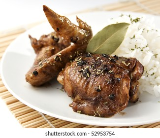 savory chicken adobo sprinkled with dried rosemary and served with rice pilaf
